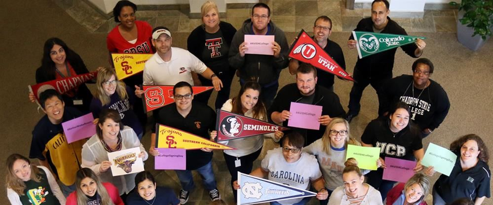 An image of AVID staff holding their college banners
